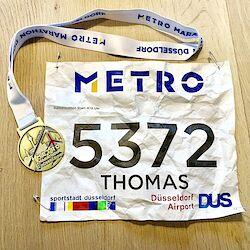 Startnummer und Medaille